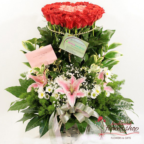Basket of red roses and pink lilies