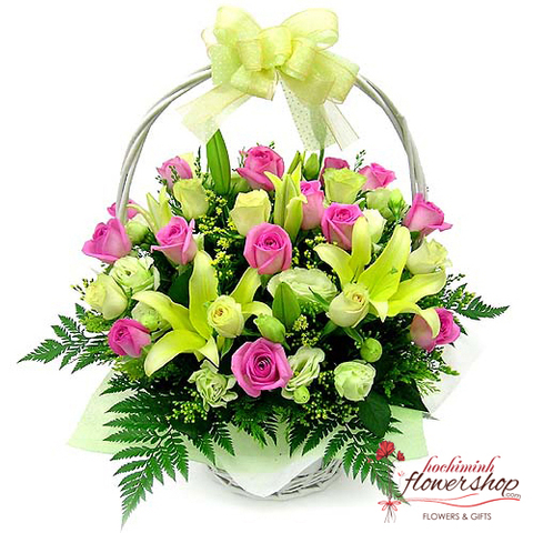Basket of pink roses and yellow lilies