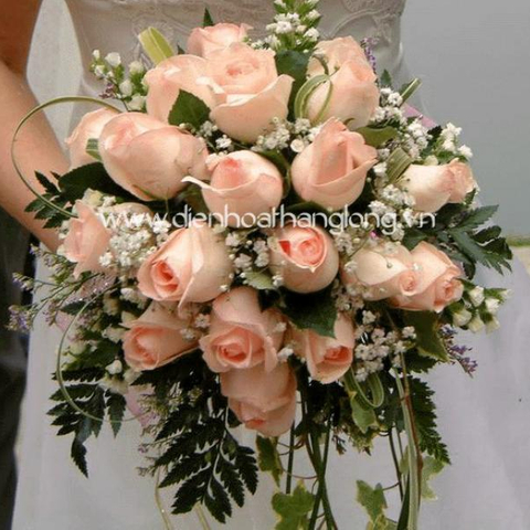 Wedding bouquet pink roses and babie flowers