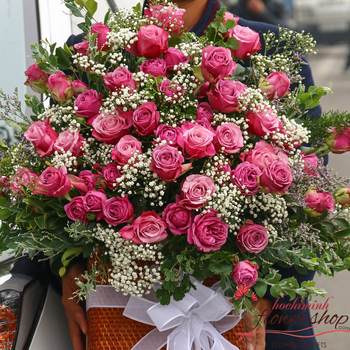 Hochiminh city purple roses arrangement basket